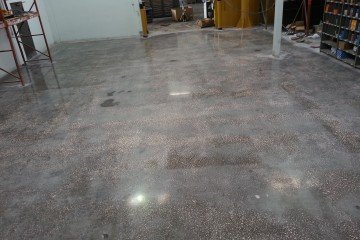 Concrete Floor resurfacing CAT tracktor garage