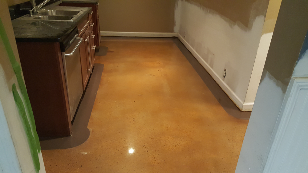 Stained concrete floor with 4 inch border in atlanta for Residential concrete floor wax